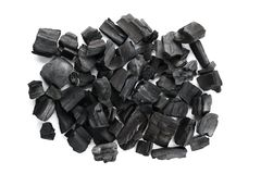 Natural hardwood charcoal. Isolated on white background. Natural hardwood charcoal isolated on white background. Top view royalty free stock photo