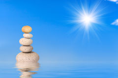 Natural Harmony. A Stack of Stones on a water with reflection Stock Photography