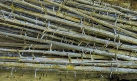 Natural Haystacks in Meadow Austria. Natural wooden Haystacks at a cabin in Salzburger Land in Austria Stock Photo
