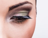 Natural health beauty of a woman face. Close-up green eyes make-up. Stock Photo