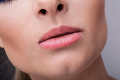 Natural health beauty of a woman face. Close-up natural lips. Stock Photo
