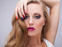 Natural health beauty of a woman face with multicolored make-up Royalty Free Stock Photography
