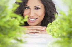 Natural Health Concept Beautiful Woman Smiling. Health spa nature concept studio portrait of a beautiful young woman or girl resting on her hands smiling through Royalty Free Stock Photography