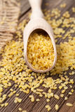 Natural healthy bulgur asian wheat grain in spoon Royalty Free Stock Image
