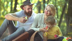 Natural and healthy family over autumn background. Family playing in autumn park and having fun. Fall foliage. Romantic stock footage