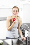 Natural and Healthy Woman eat an Apple Royalty Free Stock Photography