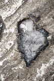 Natural heart-shaped rock Stock Photography