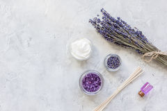 Natural herb cosmetic with lavender flatlay on stone background top view mockup Royalty Free Stock Photos