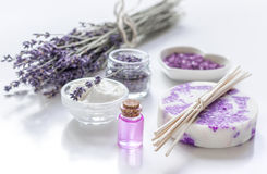 Natural herb cosmetic with lavender flowers flatlay on white background Stock Photos
