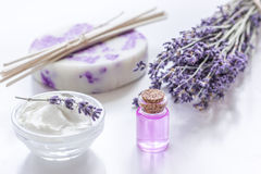 Natural herb cosmetic with lavender flowers flatlay on white background Royalty Free Stock Images