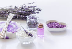 Natural herb cosmetic with lavender flowers flatlay on white background Royalty Free Stock Photos