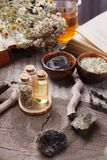 Natural herbal skin care products, top view ingredients. Cosmetic oil, clay, sea salt, herbs, plant leaves. Facial treatment preparation background, skincare royalty free stock photos