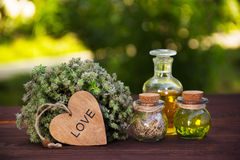 Natural herbs and oils. Aromatic thyme and magic elixir. The love drink. Love potion. Alternative medicine. Natural herbs and oils. Aromatic thyme and magic royalty free stock photo