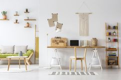Free Natural Home Office Interior Desk Organizer, Macrame On A Wall, Shelves And Couch Stock Photography - 128408962