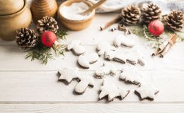 Natural homemade baking holiday cookies on a wooden white background. Shallow depth of field royalty free stock photos