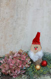 Natural homemade christmas decoration with hydrangea and santa Royalty Free Stock Photography