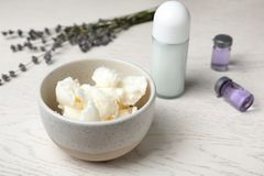 Natural homemade deodorant and ingredients. On wooden table stock photography
