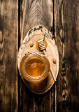 Natural honey in glass jar. Natural honey in a glass jar on a wooden trunk. On wooden background Royalty Free Stock Images