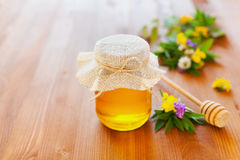 Natural honey in a pot or jar with twine tied in a bow Royalty Free Stock Photos