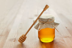 Natural honey in a pot or jar with twine tied in a bow Royalty Free Stock Images