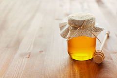 Natural honey in a pot or jar with twine tied in a bow Royalty Free Stock Image