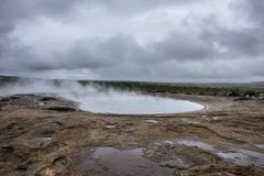 Natural Hot Springs geyser in Iceland with Steam Royalty Free Stock Image