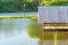 Natural hut on river. With sunlight Royalty Free Stock Image