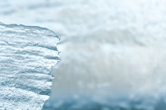 Natural ice background close-up. Ecological concept with piece of transparent frozen ice. Copy space, soft focus Stock Images