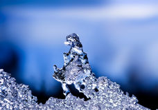 Natural ice sculpture. With a blue sky with clouds in the background Stock Images