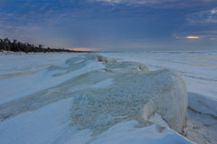 Natural Ice Sculptures on a Frozen Lake Huron at Sunset Stock Photos