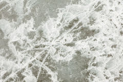 Natural Ice Surface Texture. Surface of thick ice layer on lake, weathered by numerous thaw and freeze cycles Royalty Free Stock Photos