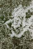 Natural Ice Surface Texture. Surface of thick ice layer on lake, weathered by numerous thaw and freeze cycles Stock Photo