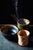 Natural incense sticks in ceramic cups Stock Image