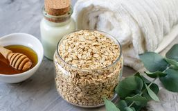 Natural Ingredients Homemade Body Oatmeal Sea Salt Scrub with Olive Oil Honey Milk. White Towel Beauty Concept Skincare Organic Aroma Spa Therapy stock photos