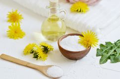 Natural ingredients for homemade body salt scrub with dandelion flowers, lemon, honey and olive oil. Natural ingredients for homemade body face hair salt scrub royalty free stock photo