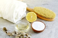 Natural Ingredients for Homemade Body Sea Salt Scrub Lemon Olive Oil White Towel. Beauty Concept Skincare Organic Wooden Body Massage Brush Aroma Spa Therapy stock photography