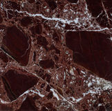 Natural Italian Rosso Levanto marble texture. Polished slab of a natural Italian Rosso Levanto Vinous marble Royalty Free Stock Image