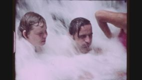 Natural Jacuzzi. PHILIPPINES, CALAUAN LAGUNA, APRIL 1980. Two Shot Sequence Of A Caucasian Tourist Couple Enjoying The Forceful Flow Of A Natural Cascading stock footage