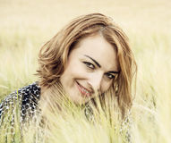 Natural joyful woman posing in the wheat field, beauty and natur. Natural joyful woman in the wheat field. Beauty and nature. Outdoor scene. Cob wheat. Female Royalty Free Stock Images