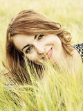 Natural joyful woman posing in the wheat field, beauty in outdoo. Natural joyful woman in the wheat field. Beauty and nature. Outdoor scene. Cob wheat. Female Stock Photography