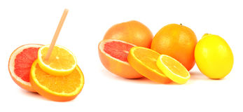Natural Juice. Concept image of assorted citrus fruits ready to drink with a straw Royalty Free Stock Image