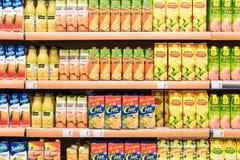 Natural Juice Bottles On Supermarket Stand Stock Photo
