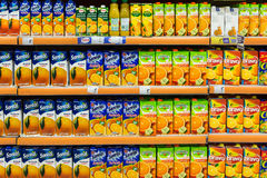 Natural Juice Bottles On Supermarket Stand Stock Photography