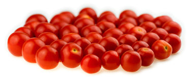 Natural, juicy cherry tomatoes  against a white background Stock Image