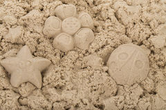 Natural kinetic sand. Background with molded shapes Royalty Free Stock Photography