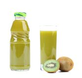 Natural kiwi juice in glass and bottle. Royalty Free Stock Images
