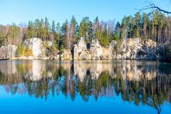 Natural lake in Adrspach rocks on sunny autumn day. Adrspach-Teplice sandstone rock town, Czech Republic.  royalty free stock photo