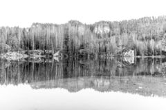 Natural lake in Adrspach rocks on sunny autumn day. Adrspach-Teplice sandstone rock town, Czech Republic. Black and white image royalty free stock photography