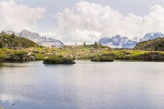 Natural lake in the high altitude mountains stock photos