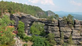 Gate in basalt cliffs in national park reserve Bohemian Switzerland in Czech. Natural landmark, gate in basalt cliffs in national park reserve Bohemian stock video footage
